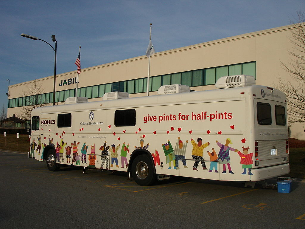 A blood collection bus (bloodmobile) from Children's Hospital Boston at a manufacturing facility in Massachusetts: Blood banks sometimes use a modified bus or similar large vehicle to provide mobile facilities for donation.