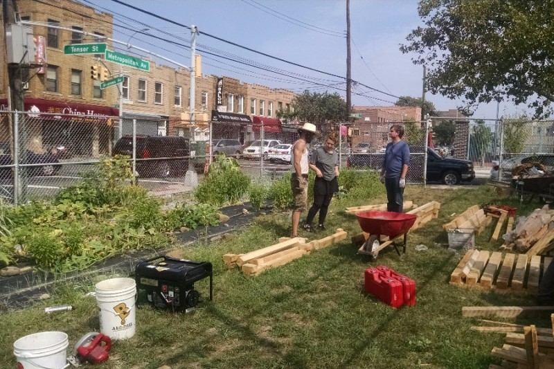 Volunteers work in the Garden. (Photo courtesy Ridgewood Community Garden on Facebook)