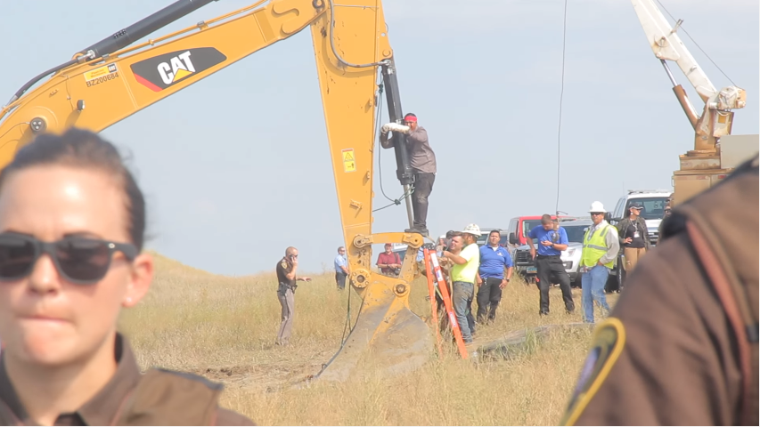 "The #NoDAPL water protectors who have come to stand with Standing Rock Sioux Tribe took non-violent direct action by locking themselves to construction equipment. This is ""Happy"" American Horse from the Sicangu Nation, hailing from Rosebud. (Photo by Desiree Kane)"